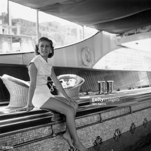 Athina Livanos Onassis the first wife of Greek shipowner Aristotle Onassis relaxing by the swimming pool aboard their yacht, the 'Christina' in Monte...