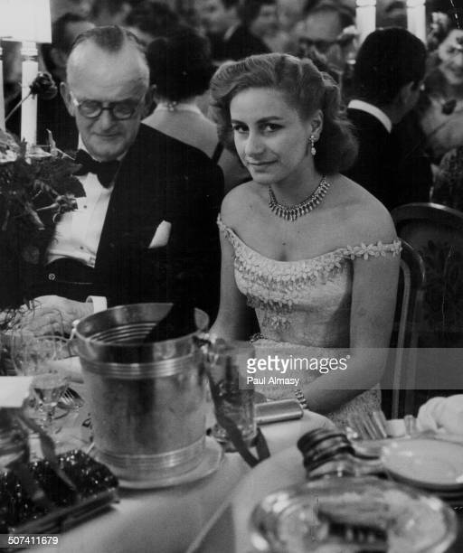 Athina Livanos, wife of ship owner Aristotle Onassis, attending a dinner, 1960.