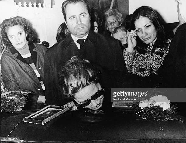 Athina Niarchos the wife of Greek shipping magnate Stavros Niarchos mourns over the casket of her son Alexander Onassis her son with former husband...
