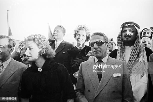 Athina Onassis, , and proud husband Aristotle Onassis, , are shown in the company of Saudi-Arabian Minister of Economy Mohammed Abdullah Alireza, as...