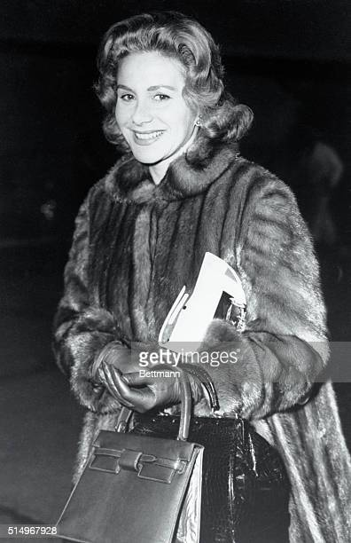 Athina Onassis the attractive wife of millionaire Greek ship owner Aristotle arrives at London Airport well muffled in a fur coat from Paris She was...