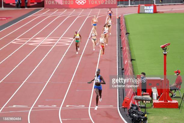 Athing Mu of Team United States crosses the finish line winning the gold medal in the Women' s 4 x 400m Relay Final on day fifteen of the Tokyo 2020...