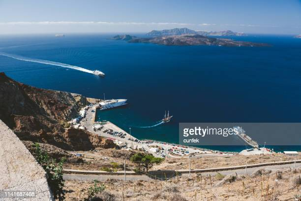 athinios port from above, santorini - greek islands stock pictures, royalty-free photos & images