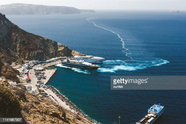 athinios port with ferry parked, santorini - moored stock pictures, royalty-free photos & images