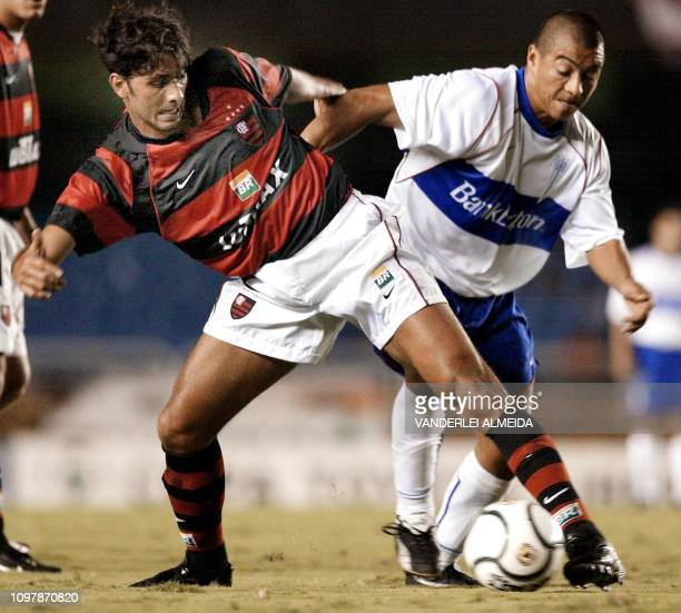 Athirson of Flamengo de Rio fights for the ball with chilean Ormazabal of the Universidad Catolica de Chile during the Copa Libertadores de America...