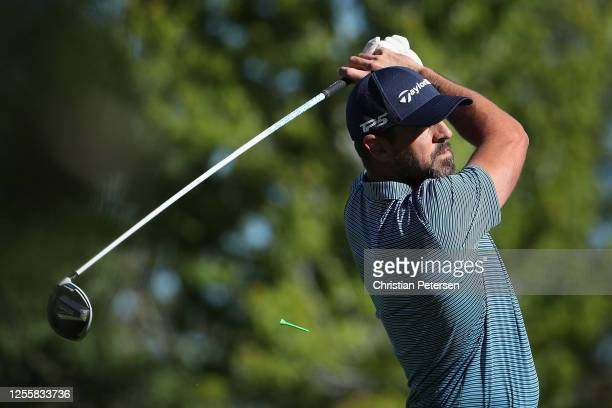 NFL athlete Aaron Rogers of the Green Bay Packers plays a tee shot on the first hole during the final round of the American Century Championship at...