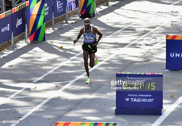 Athlete Abdi Abdirahman approaches the finish line to earn third place and the top American finish with TAG Heuer Official Timekeeper for The New...