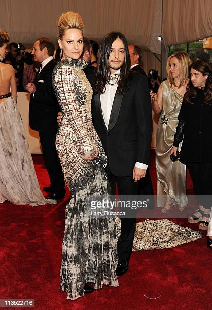 """Athlete Aimee Mullins and designer Olivier Theyskens attend the """"Alexander McQueen: Savage Beauty"""" Costume Institute Gala at The Metropolitan Museum..."""