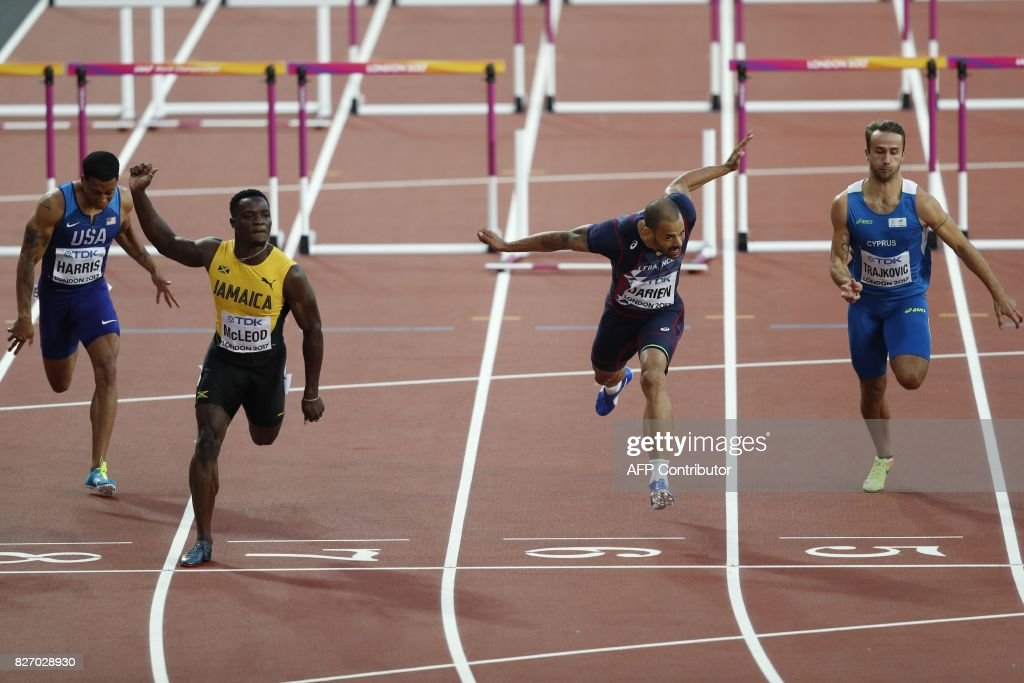 US athlete Aleec Harris, Jamaica's Omar Mcleod, France's Garfield Darien and Cyprus' Milan Trajkovic compete in the semi-finals of the men's 110m hurdles athletics event at the 2017 IAAF World Championships at the London Stadium in London on August 6, 2017. / AFP PHOTO / Adrian DENNIS
