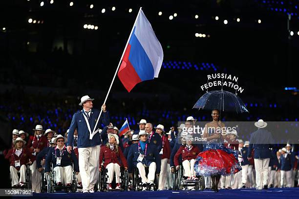 Athlete Alexey Ashapatov of Russia carries the flag during the Opening Ceremony of the London 2012 Paralympics at the Olympic Stadium on August 29...