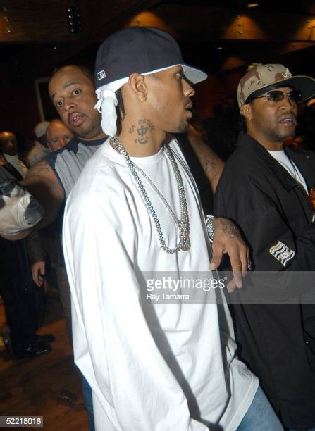 NBA athlete Allen Iverson walks through Shaquille O'Neal and Amare Stoudemire's East Meets West NBA AllStar Affair at Serengehti February 18 2005 in...