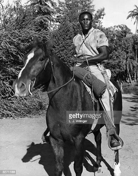 Athlete and film actor Rafer Johnson in a scene from the film 'The Fiercest Heart', directed by George Sherman for 20th Century Fox.