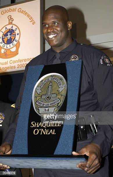 Athlete and Los Angeles Port Police Officer Shaquille O'Neal receives an award of appreciation at the Conference of the International Association of...