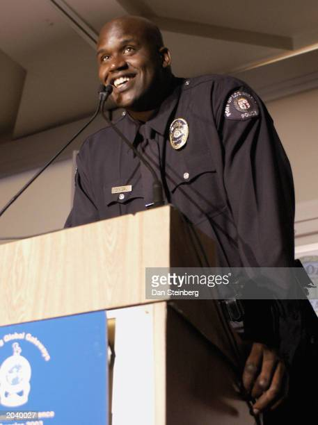 Athlete and Los Angeles Port Police Officer Shaquille O'Neal speaks after receiving an award of appreciation at the Conference of the International...