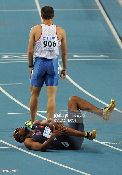 US athlete Angelo Taylor lies on the ground following the men's 400 metres hurdles final at the International Association of Athletics Federations...