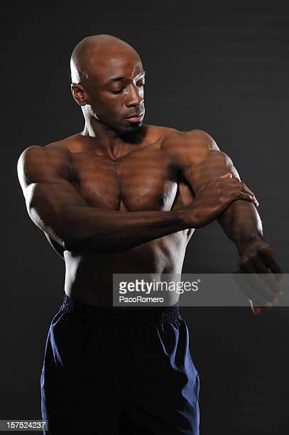Athlete applying oil