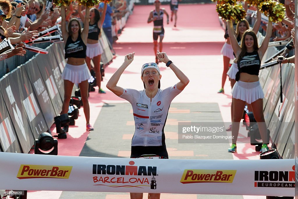 Athlete Astrid Stienen from Germany celebrates winning the women race during Ironman Barcelona on October 2, 2016 in Calella, near Barcelona, Spain.