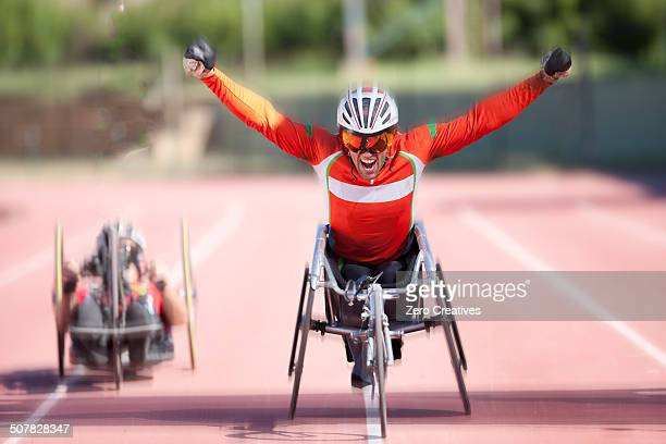 athlete at finishing line in para-athletic competition - 競争 ストックフォトと画像