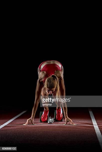athlete at starting line - 陸上競技大会 ストックフォトと画像