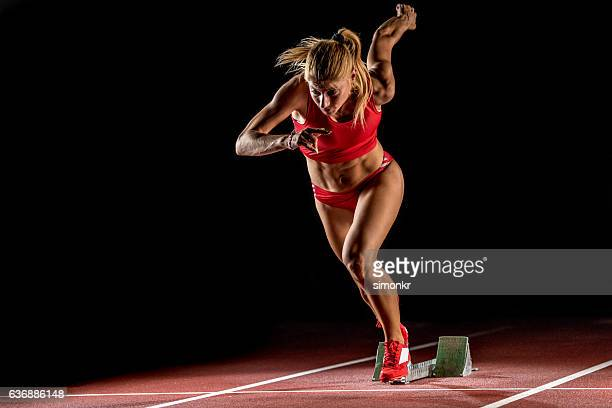 athlete at starting line - athletics stock photos and pictures