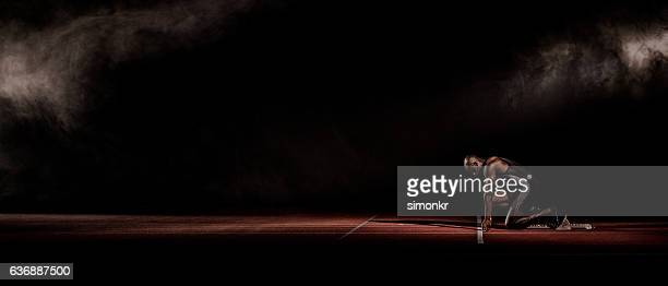 athlete at starting line - 陸上競技 ストックフォトと画像
