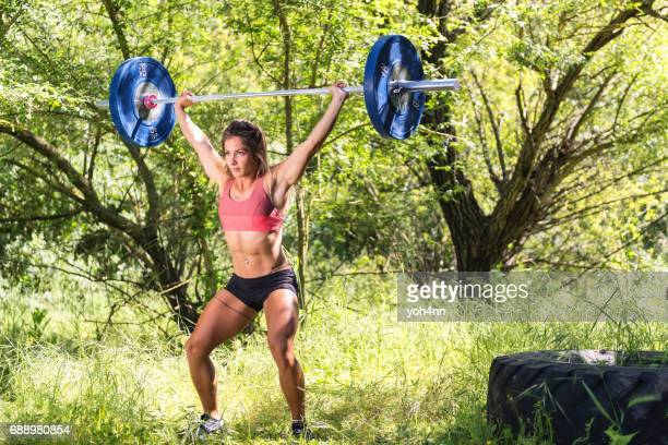 athlete & barbell & nature - snatch weightlifting stock photos and pictures