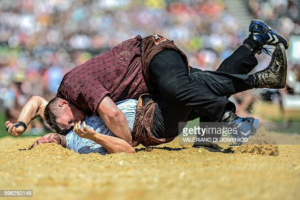 Athlete Beat Wickli fight against Christian Stucki during the first day of the Federal Alpine Wrestling Festival on August 27 2016 in Payerne western...