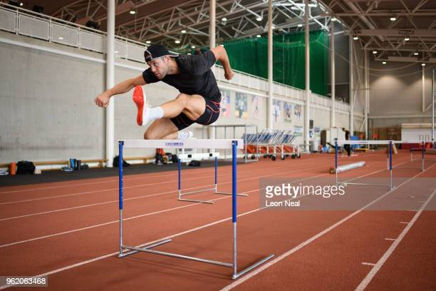 Athlete Ben Gregory practises on an indoor hurdle track at the British Athletics National Performance Institute on May 24 2018 in Loughborough...