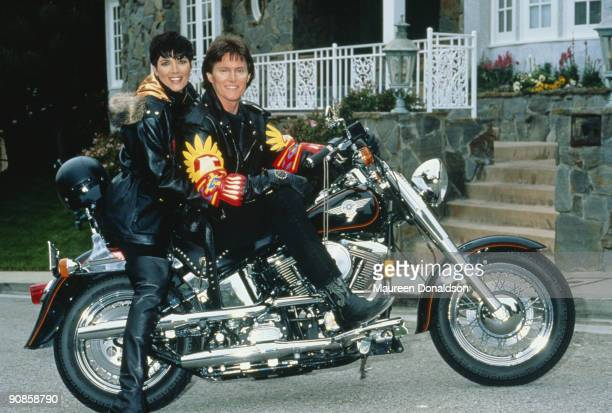 US athlete Bruce Jenner poses on a HarleyDavidson with his partner Kris Jenner formerly Kris Kardashian circa 1991