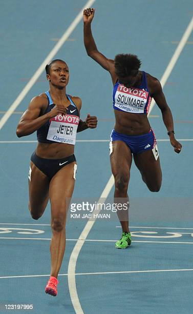 US athlete Carmelita Jeter and France's Myriam Soumare compete in the women's 200 metres semifinal at the International Association of Athletics...