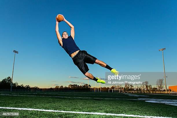 Athlete catches football
