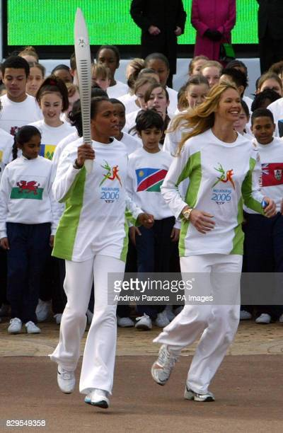 Athlete Cathy Freeman and model Elle MacPherson start the 180000 kilometre global relay from Buckingham Palace to Melbourne The journey will embrace...
