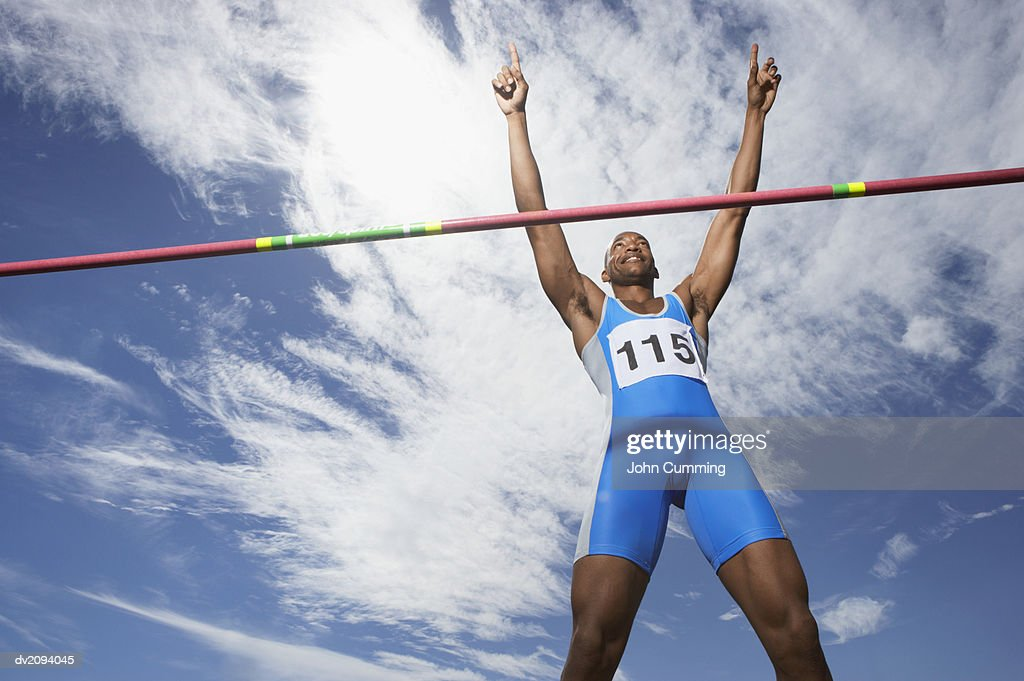 Athlete Celebrating After Doing the High Jump : Stock Photo