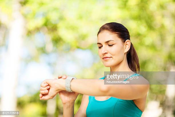Athlete Checking Race Time On Watch At Park