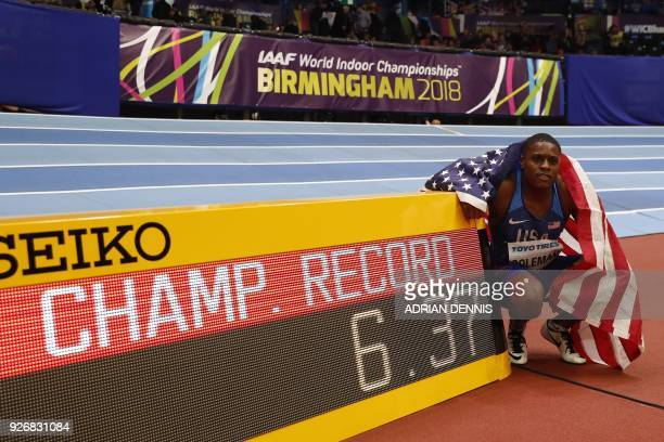TOPSHOT US athlete Christian Coleman celebrates winning the men's 60m final at the 2018 IAAF World Indoor Athletics Championships at the Arena in...