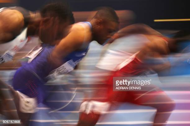 US athlete Christian Coleman competes in the men's 60m semifinal at the 2018 IAAF World Indoor Athletics Championships at the Arena in Birmingham on...