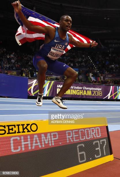 US athlete Christian Coleman poses after winning the men's 60m final at the 2018 IAAF World Indoor Athletics Championships at the Arena in Birmingham...