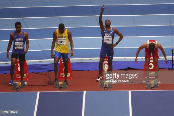 US athlete Christian Coleman raises his arm at the start of the men's 60m round 1 event at the 2018 IAAF World Indoor Athletics Championships at the...