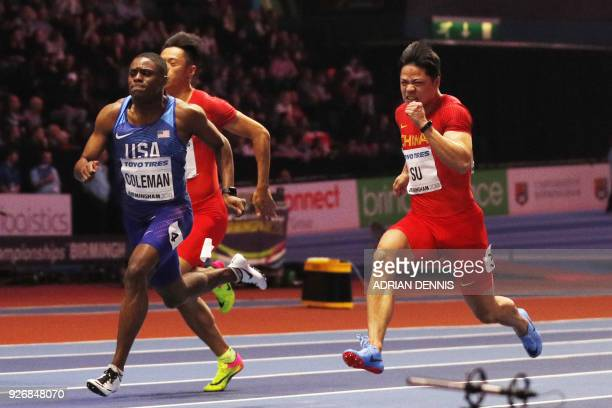 US athlete Christian Coleman wins ahead of China's Su Bingtian during the men's 60m final at the 2018 IAAF World Indoor Athletics Championships at...