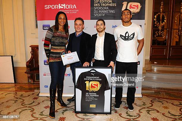 Athlete Christine Arron Antoine Biard David Blough and athlete Jimmy Vicaut pose for a photo as they attend the 'Trophees Sporsora Du Marketing...