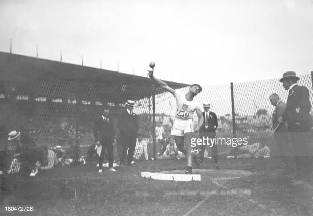 US athlete Clarence Houser puts the shot during the Olympic Games in Paris July 1924 where he won the gold medal in both the discus and shot put...