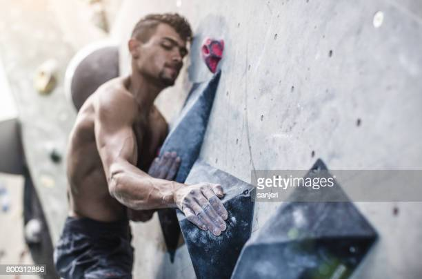 Athlete Climbing in a Bouldering Gym
