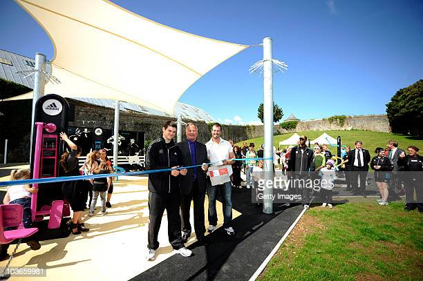Athlete Craig Pickering cuts the ribbon next to and Councillor Peter Brookshaw at the opening of the adidas London 2012 adiZone an outdoor gym...