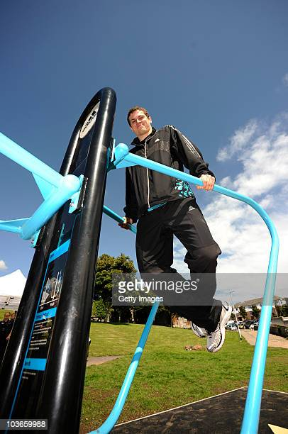 Athlete Craig Pickering poses with the outdoor gym equipment during the opening of the adidas London 2012 adiZone an outdoor gym facility on August...