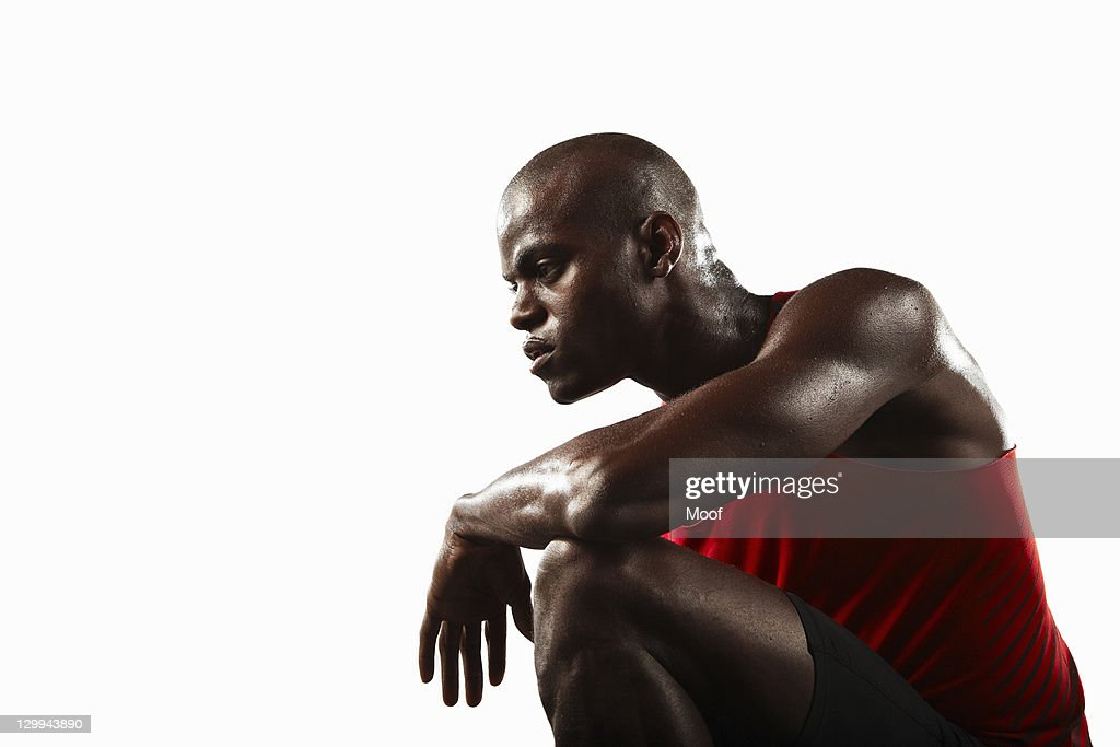 Athlete crouching : Stock Photo