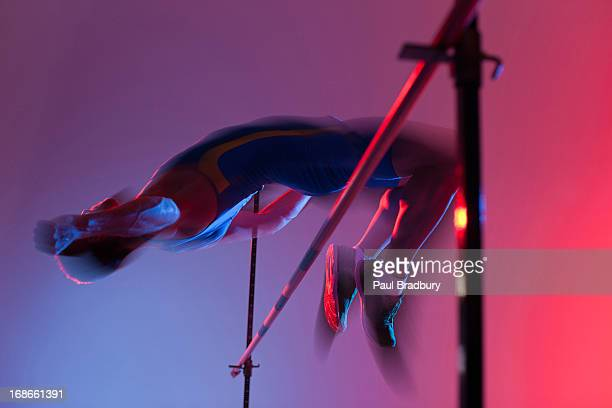 athlete curling over high jump - high jump stock pictures, royalty-free photos & images