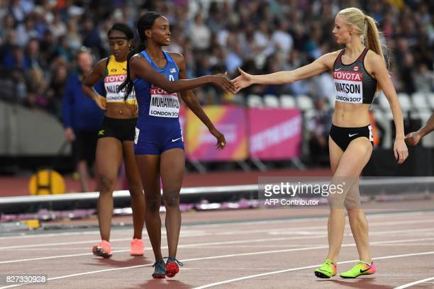 US athlete Dalilah Muhammad gestures to Canada's Sage Watson after her victory in a heat of the women's 400m hurdles athletics event at the 2017 IAAF...