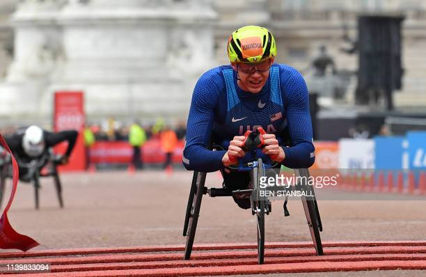 US athlete Daniel Romanchuk crosses the finish line to win the men's wheelchair race of the 2019 London Marathon in central London on April 28 2019 /...