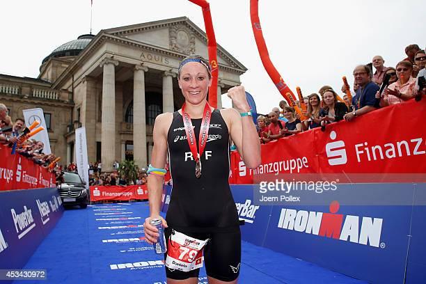 Athlete Daniela Ryf of Switzerland celebrates after winning the Ironman 703 European Championship on August 10 2014 in Wiesbaden Germany