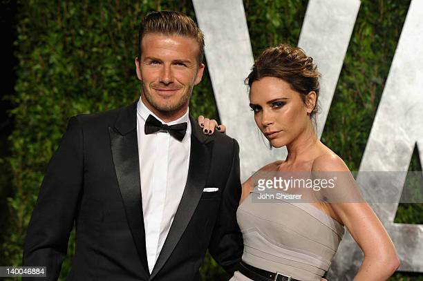 Athlete David Beckham and fashion designer Victoria Beckham arrive at the 2012 Vanity Fair Oscar Party hosted by Graydon Carter at Sunset Tower on...